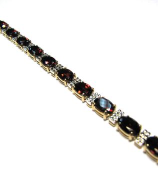 Золотой браслет с аметистом, бриллиантом, гранатом, перидотом, топазом и цитрином арт. 330120км 330120км